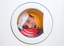 Man in a washing machine Stock Images
