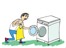 Man and washing machine. Man Doing Laundry. Royalty Free Stock Images