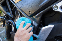 The man washing the motorcycle Royalty Free Stock Photos