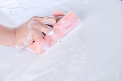 Man washing a soapy white car with a pink sponge Stock Photography