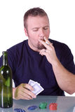 Man wat a Poker Table Stock Photo