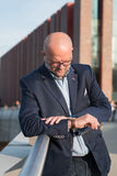 The man with the watch before meeting. Stock Image