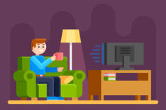 Man watches TV on sofa Royalty Free Stock Image
