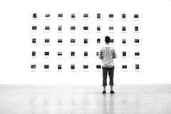 Man watching art Stock Images