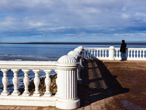 A man is watching the Baltic sea from the observation deck. Observation deck. Veiw of the Baltic sea from the Palace and Park Ensemble Peterhof Stock Photos