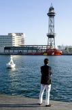 Man watching Barcelona port Royalty Free Stock Image