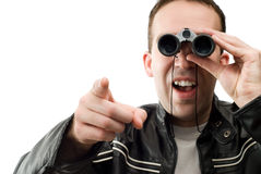 Man Watching With Binoculars. Closeup view of a man watching through a set of binoculars and pointing, isolated against a white background Stock Image