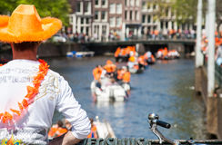 Man is watching boats - Koninginnedag 2012 stock photos