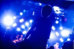 Man Watching Concert Stock Photography
