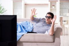 The man watching 3d tv at home stock image