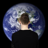 Man watching earth Royalty Free Stock Image