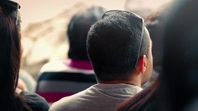 Man Watching Event In Crowd stock footage