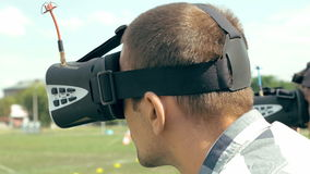 Man watching flight of FPV drone using VR glasses stock video footage