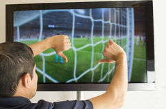 Man watching football. With your finger down- thumbs down stock images