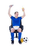 Man watching football and celebrating goal Stock Photo