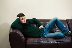 Man watching football taking a rest, football fan stock images