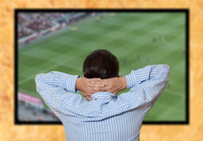 Man watching football game Stock Photos