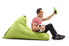 Man watching football and having a beer royalty free stock image