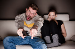 A man watching football, while his girlfriend is Stock Image