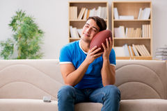 The man watching football at home sitting in couch Stock Photography