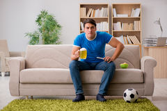 The man watching football at home sitting in couch Royalty Free Stock Photos