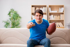 The man watching football at home sitting in couch Royalty Free Stock Photography