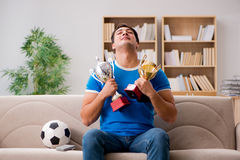 The man watching football at home sitting in couch Royalty Free Stock Images