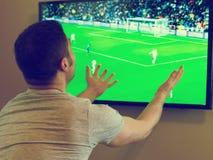 Man watching football. Royalty Free Stock Photo