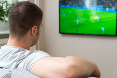 Man watching football. Stock Images