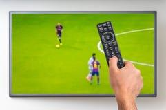 Man is watching football match on TV Stock Photos
