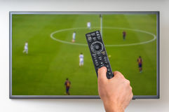 Man is watching football match on TV Royalty Free Stock Images