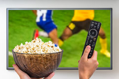 Man is watching football match on TV Stock Images