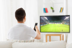Man watching football or soccer game on tv at home Royalty Free Stock Images