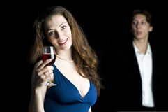 Man watching a girl. With a glass of wine royalty free stock photos