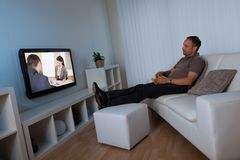 Man watching home movies Royalty Free Stock Photos