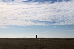 Man watching horizon in a desert or beach Stock Photo