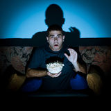 Man watching horror movie Royalty Free Stock Photos