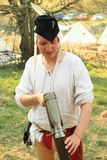 Man watching medieval gun Royalty Free Stock Image