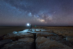 Man watching the Milky Way from a jetty Royalty Free Stock Images