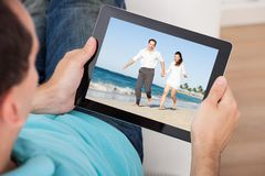 Man watching movie on digital tablet Stock Photo