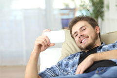 Man watching movies in a smart phone Royalty Free Stock Photography