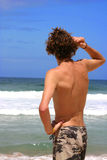 Man watching ocean. Man watching to the ocean at the beach Stock Photo