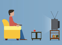 Man watching old television on sofa Stock Photo