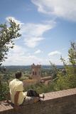 Man watching over Tuscan landscape in San Miniato, Italy Royalty Free Stock Photography