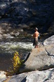 Man watching river from rocks Stock Photos