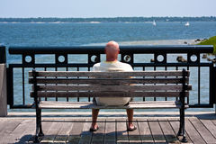 Man Watching Sailboats Stock Image