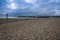 Man watching sea sky pebbles. Man along the somerset coast sea and sky Stock Photo