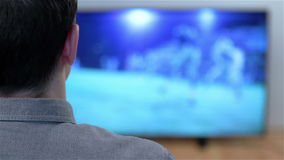 Man watching smart tv in living room stock video footage