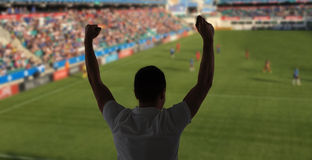 Man watching soccer of football game on stadium Stock Photography