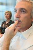 Man watching something thoughtfully. Senior men deep in thought Stock Image